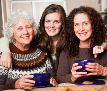 elder women and young lady smiling